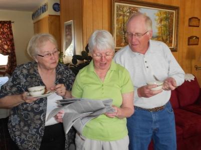Parents reading paper