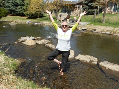 Yoga tree pose in creek
