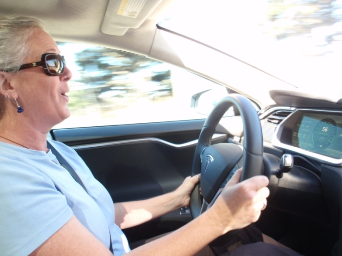 Woman driving Tesla