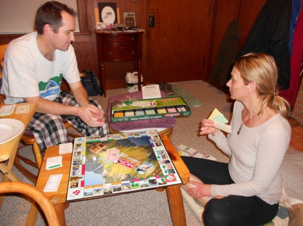Man and woman playing Monopoly