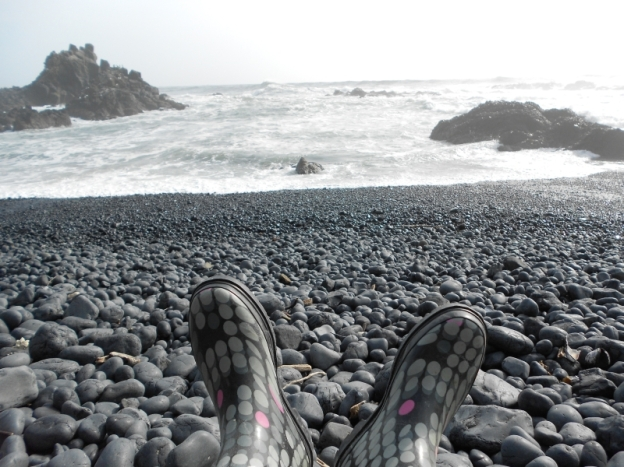 Boots and cobble beach
