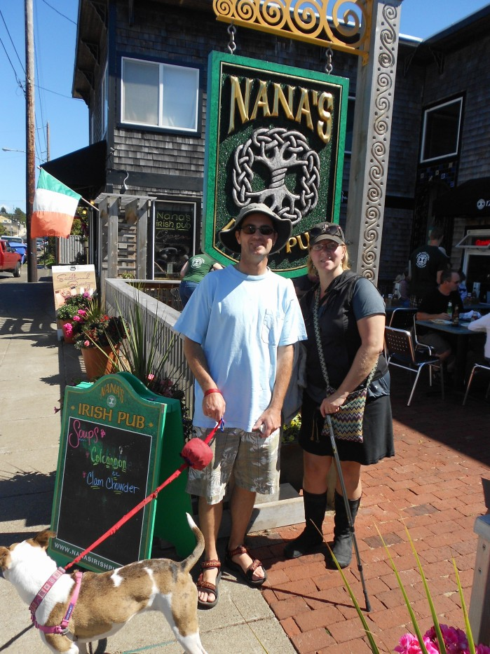 Man and woman in front of Nana's Pub in Newport
