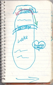 hand-drawn image of a lake on lined notebook paper