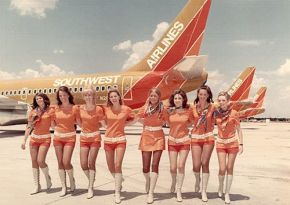 photo of 1970s Southwest Airlines stewardesses in front of plane